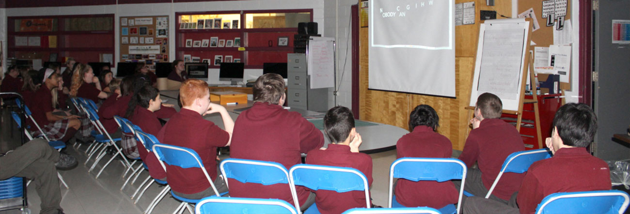 Classroom with students watching private screening of student movie